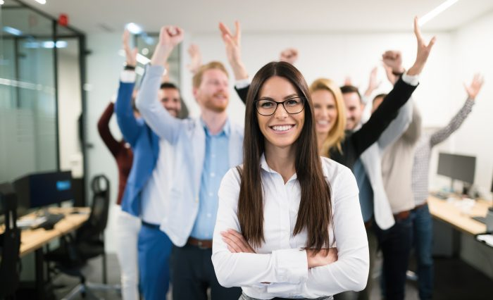 Portrait of group of successful businesspeople happy at work